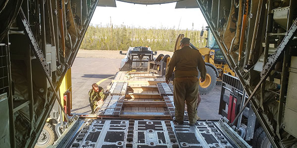 The rollerized trailer at ILS is used for loading and unloading heavy cargo.