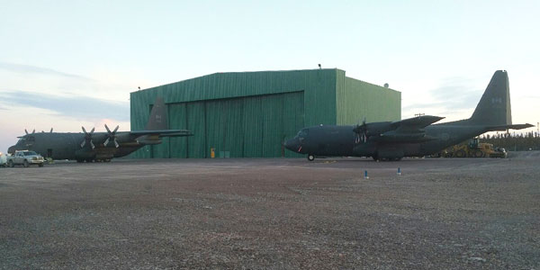 The parking area at ILS is a combination of pavement and gravel. It can facilitate parking of two C130 aircraft.